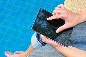 Businessman Working On Pc Tablet With Feet In The Pool