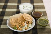 stock photo of tamarind  - Dahi Bhalle Chaat or Stuffed Panipuri with Curd and Sweet Tamarind Indian Dish - JPG