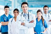 stock photo of hospital  - Doctor leading a medical team at the hospital - JPG