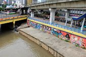KUALA LUMPUR, MALAYSIA - AUGUST 2013 : 10 meter long of Graffiti street art along the Klang River near the Pasar Seni LRT station in Kuala Lumpur, Malaysia on August 11, 2013.