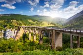 Old big bridge in Durdevica and fantastic view Tara river gorge - is the biggest one canyon in Europe in the national park Durmitor, Montenegro. Balkans. Beauty world.