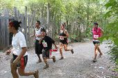 MUSKOGEE, OK - Sept. 14: Runners hurry through zombie-infested forest during the Castle Zombie Run a