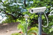 stock photo of cctv  - White CCTV camera watching for security 24 hours at car park