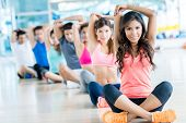 image of stretching exercises  - Group of fit people at the gym exercising - JPG