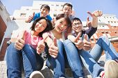 picture of thumb  - happy and smiling students thumbs up together at school - JPG