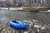 a packraft (one-person light raft used for expedition or adventure racing) on a shallow river - Cach