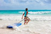 foto of boogie board  - Little boy on vacation having fun surfing on boogie board - JPG