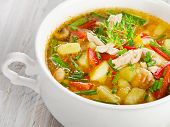 stock photo of vegetable soup  - Bowl of vegetable soup with chicken and herbs - JPG