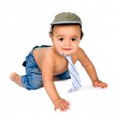 Cute African baby boy crawling in his little jeans