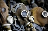stock photo of rubber mask  - Old gas masks from world war two - JPG