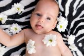 Baby girl and flowers