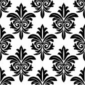 stock photo of damask  - Bold foliate arabesque motif in black and white in a repeat seamless pattern suitable for damask style wallpaper and textile design - JPG