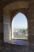 Lisbon, Portugal - February 01, 2013: Gothic window of a tower of the Sao Jorge (St. George) Castle