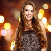 Beautiful  Young Smiling Woman With Long Hairs Looking At Camera.