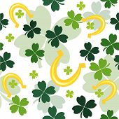 Seamless pattern with clover leaves and horseshoes