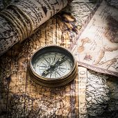 vintage  still life with compass on the old map..map used for background is in Public domain. Map so