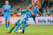 VIENNA, AUSTRIA - AUGUST 22 Louis Schaub (#21 Rapid) and Giorgi Iluridze (#10 Dila Gori) fight for t