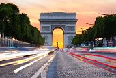 picture of charles de gaulle  - Champs-Elysees towards the Arc de Triomphe at sunset, Paris, France