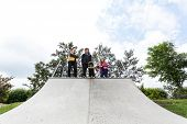 Teenagers Standing On A Halfpipe