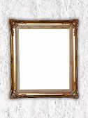 Golden Frame On Whtie Cement Wall