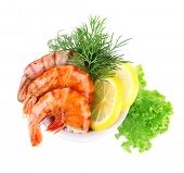 Fresh boiled prawns with dill and lemon in a blue round bowl on white background isolated