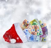 Euro banknotes coming out of Santa Claus hat