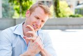 stock photo of stiff  - Closeup portrait young man having acute bad joint pain in his hands writer - JPG