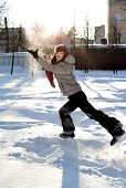 picture of ruddy-faced  - funny teenager girl playing in deep snow - JPG
