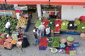 SAFRANBOLU, TURKEY - JUNE 23, 2012: People buy fruits and vegetables on the street market. Locals pr