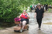 MUSKOGEE, OK - MAY 24: Woman in a wheelchair enjoys the Oklahoma 19th annual Renaissance Festival on May 24, 2014 at the Castle of Muskogee in Muskogee, OK.