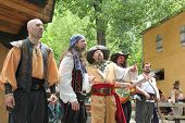 MUSKOGEE, OK - MAY 24: Men dressed as pirates sing at the Oklahoma 19th annual Renaissance Festival