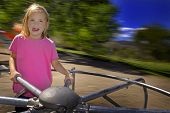 stock photo of merry-go-round  - Little girl playing on merri - JPG