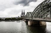 Cologne, Germany - August 26: Hohenzollern Bridge, The Cologne Cathedral And The River Rhine On Augu