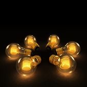 Six Incandescent Lightbulbs In A Circle On Dark Background