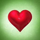 red heart against green vignette