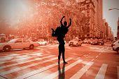 Ballerina stretching against new york street