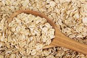 Oatmeal on a wooden spoon