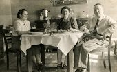 GERMANY, CIRCA THIRTIES: Vintage photo of family eating cake and drinking alcohol