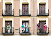 Building With Dresed Manequins On Balconies On A Street Of Madrid, Spain