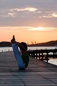 Practicing yoga asanas during the sunset