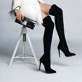 image of slender legs  - Beautiful slender female legs in elegant boots stockings - JPG