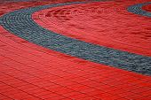 Cobblestone Sidewalk Made Of Cubic Red And Gray Stones