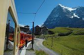 Eiger Mountain And Train In Kleine Scheidegg In Switzerland