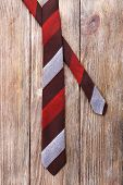 Stripped tie on wooden planks background