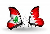 stock photo of bahrain  - Two butterflies with flags on wings as symbol of relations Lebanon and Bahrain - JPG
