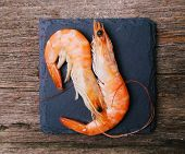 Delicious shrimps on the wooden table