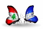 Two Butterflies With Flags On Wings As Symbol Of Relations Lebanon And Honduras