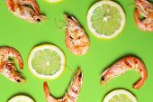Delicious shrimps on a green background