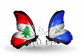 Two Butterflies With Flags On Wings As Symbol Of Relations Lebanon And Nicaragua