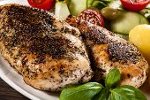 Roast chicken fillets, boiled potatoes and vegetables